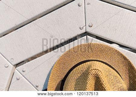 Straw Hat On White Table Near The Beach. Top View