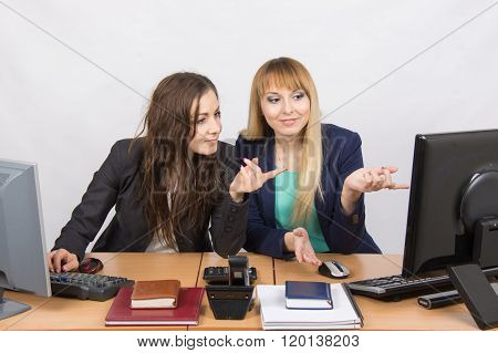 Two Colleagues In The Office To Discuss The Electronic Document In A Computer Screen