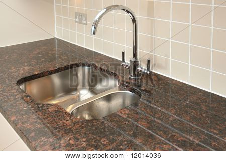 Kitchen sink with granite work surface.