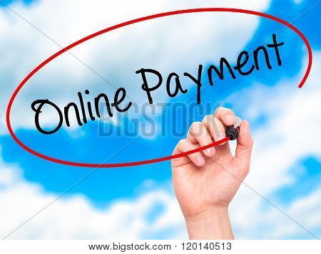 Man Hand Writing Online Payment With Black Marker On Visual Screen.