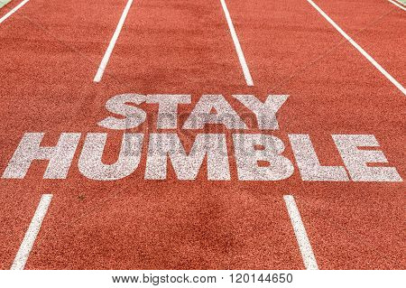 Stay Humble written on running track