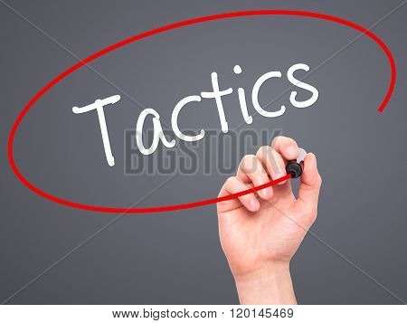 Man Hand Writing Tactics With Black Marker On Visual Screen.