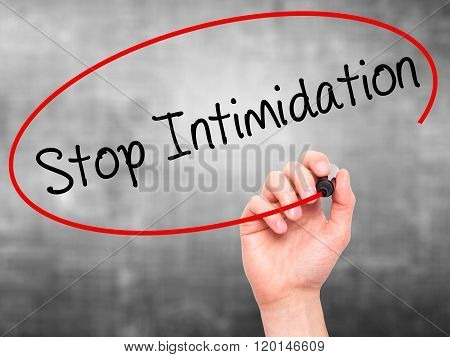 Man Hand Writing Stop Intimidation With Black Marker On Visual Screen.