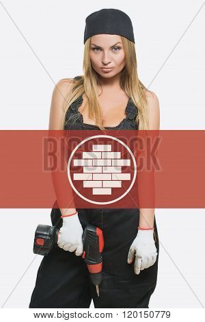 sexy female holding a cordless screwdriver. brickwork icon in the background woman.