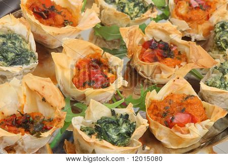 Filo tartlets with spinach and ricotta or tomato and red pepper.