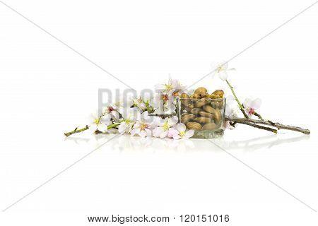 Raw almonds with some almond sticks