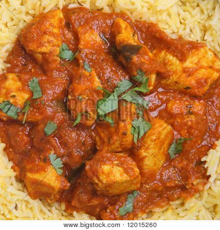 Indian chicken Madras curry with pilau rice.