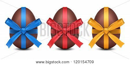 Collection Of 3D Chocolate Easter Eggs With Colorful Ribbon Bows