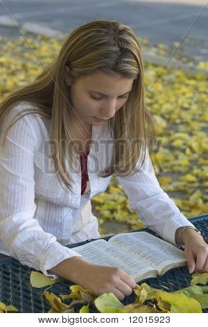 A young woman reading.