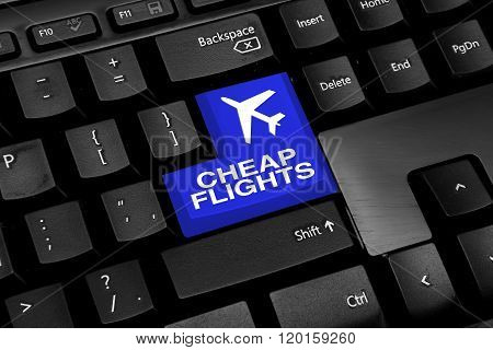 Computer keyboard with blue cheap flights button