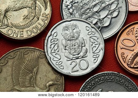 Coins of New Zealand. Maori carving of Pukaki depicted in the New Zealand 20 cents coin.