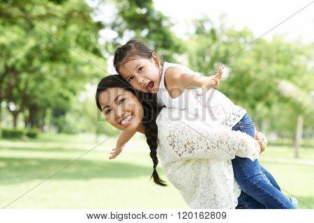 Joyful mother and daughter