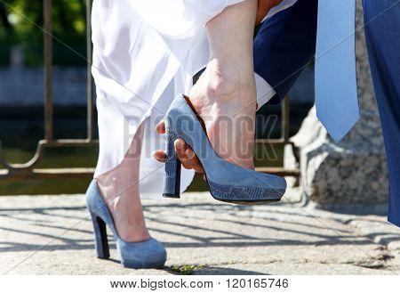 Groom Helps Bride To Put On Her Shoe