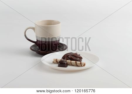 Cup Of Coffee And Chocolate Candy, Marsh-mallow And Wafer Roll On Plate