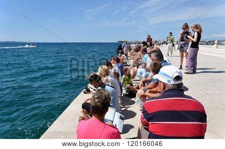 People Relaxing Near The Sea Organ. Coast Of Zadar, Croatia