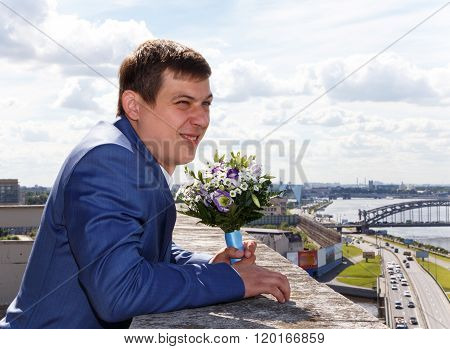 Portrait Of Funny Groom With Grimace On His Face