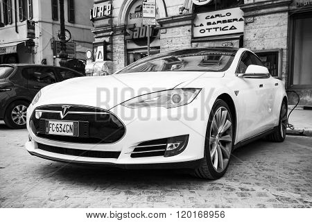 White Tesla Model S Car Parked On Roadside