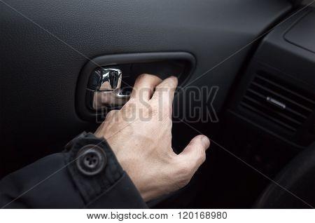 Male Hand Opens The Car Door With Inner Handle