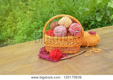 Wicker basket with knitting