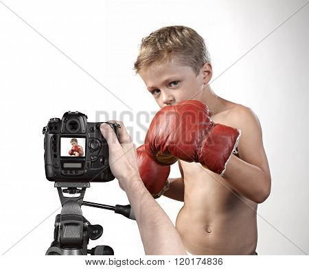 Taking Picture Of A Cute Little Boy With Boxing Gloves