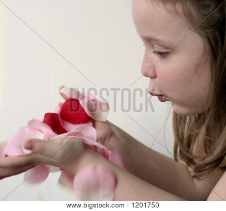 Girl Blowing Petals F