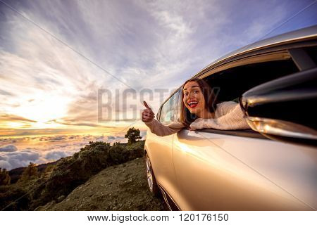 Woman traveling by car