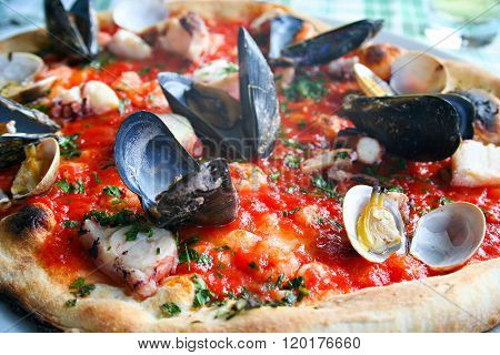 Italian pizza with seafood