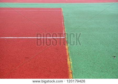 Tennis Court Rubber Play Game Background Texture Pattern With Erased Yellow Line. Old And Untidy Lan