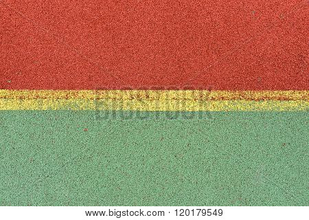 Detail Of Yellow Lines On Football Playground. Detail Of Lines In A Soccer Field Made From Red And G