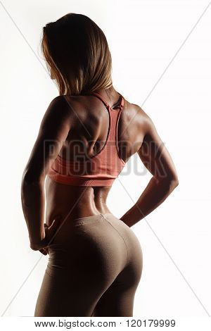 Beautiful Young Athletic Girl, With Sport Body Wet, Sexual Booty On A White Studio Background