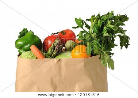 Produce in paper grocery bag isolated over white background