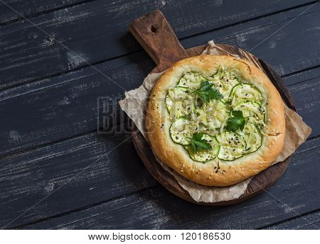Vegan Zucchini Pizza On A Rustic Cutting Board On Dark Wooden Background. Healthy Food