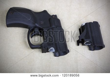 Tubeless Doubly Charged Traumatic Pistol And Holder. Image With Vignette