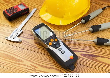 Electronic Instrument For Measuring Of Temperature Probes On Wood Background