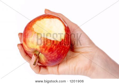 Bitten Red Apple In Hand