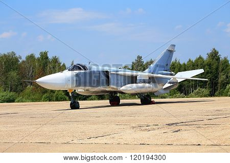 RYAZAN REGION  -  JULY 27: Russian bomber SU 24 parked at a military airbase for service -  on July  27, 2015 in Ryazan region