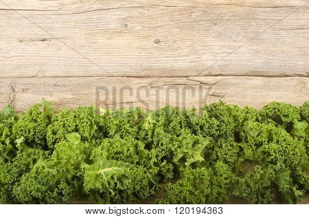 Curly Kale On A Rustic Table