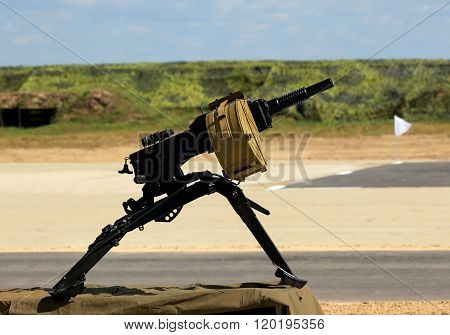 RYAZAN REGION  AUGUST 3: 30 mm infantry automatic grenade launcher with attached box for ammunition on the tripod  - on August 3, 2015  in Ryazan region