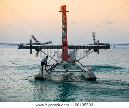 Raa ATOLL, MALDIVES - OCTOBER 12 2016: Twin otter red seaplane at Maldives