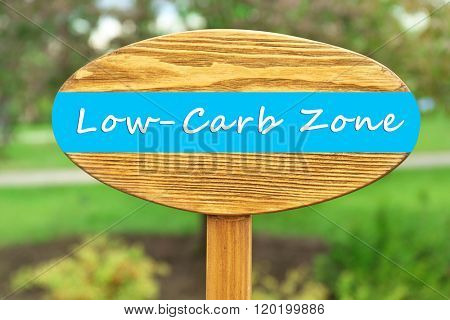 Low-Carb Zone text on wooden pointer on natural background