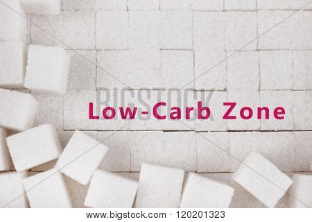 White refined sugar background and text Low-Carb Zone on it