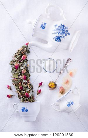 Magic teapot pouring tea from dry herbs