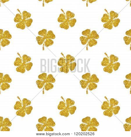 Seamless pattern of abstract four-leaf clovers of gold glitter