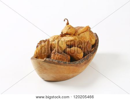 bowl of sun dried figs on white background