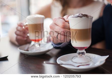 Man And Woman Holding Cup Of Latte