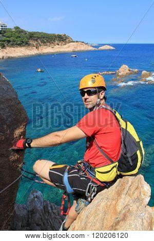 Mountaneer Relaxing On A Rock