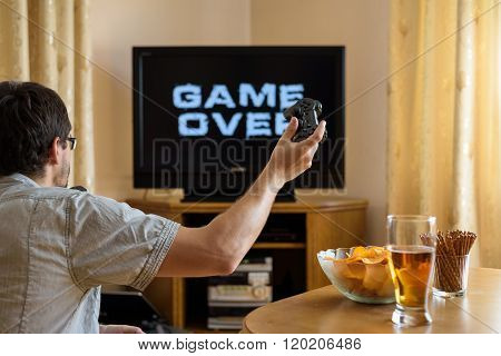 Man Playing Video Games And Losing - Game Over - Stock Photo