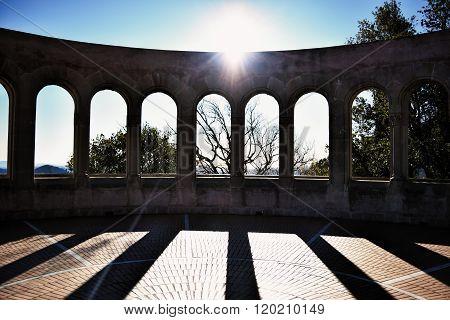 Sun shining over the arcade arch building on Montserrat