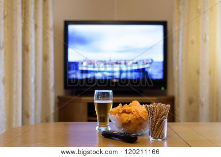 Tv, Television Watching (refugee Boat, News) With Snacks