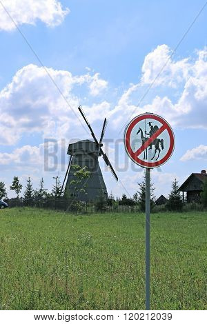 Old Windmill And Road Sign To Don Quixote Passage Banned In Dudutki, Belarus